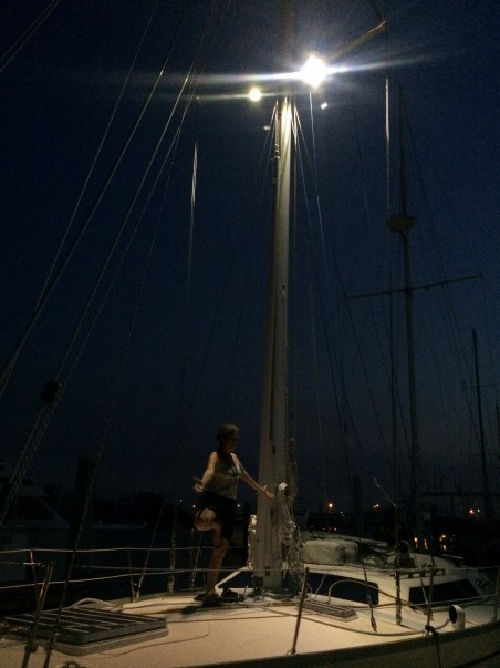 The mast is up, yoga under the lights.